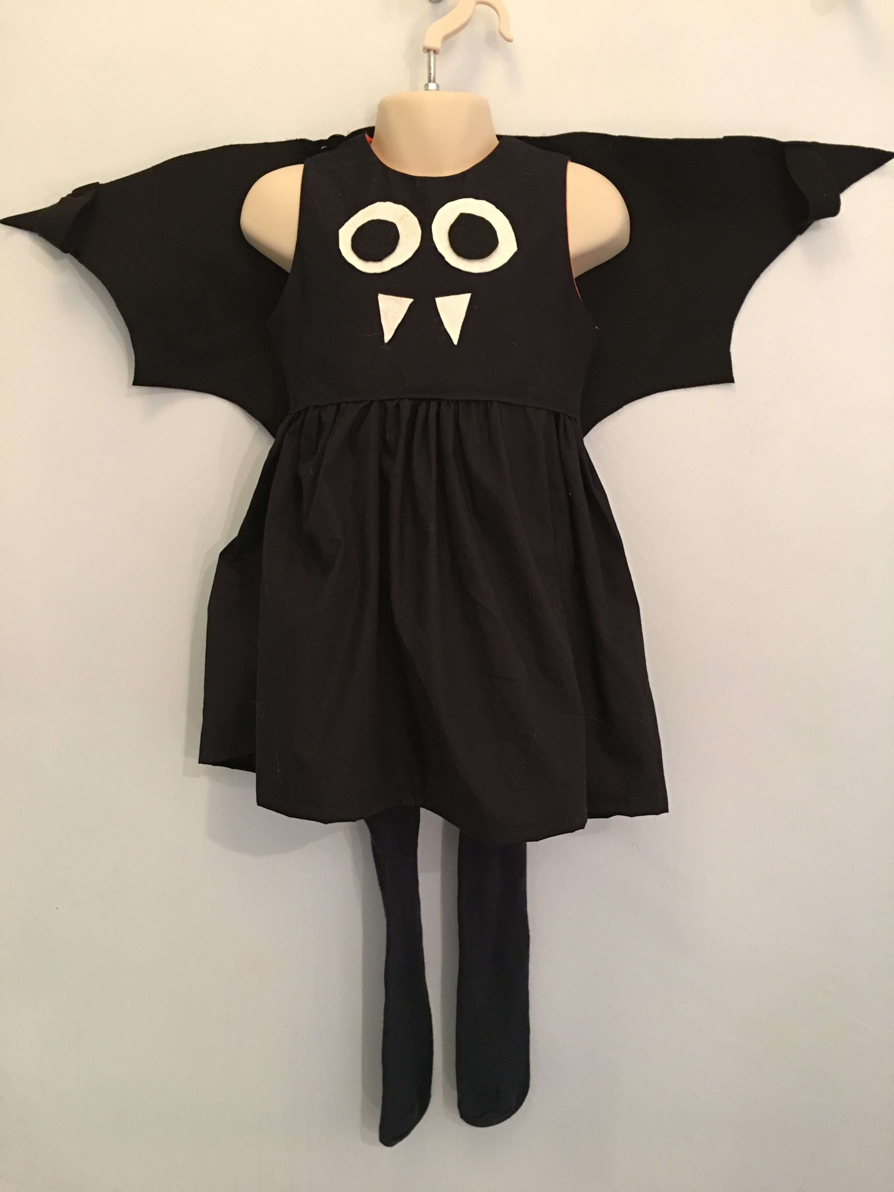Bat costume - Halloween Outfits Made Around A simple Black Dress - outfits for children dressing up that use a black dress as their base #halloweencostumes #halloweenoutfits #halloweenpartyideas #halloweencostumesforkids #halloweendiy #halloweencrafts #halloweencostumeideas #halloweenwitch #dressingup #dressupideas #batcostume