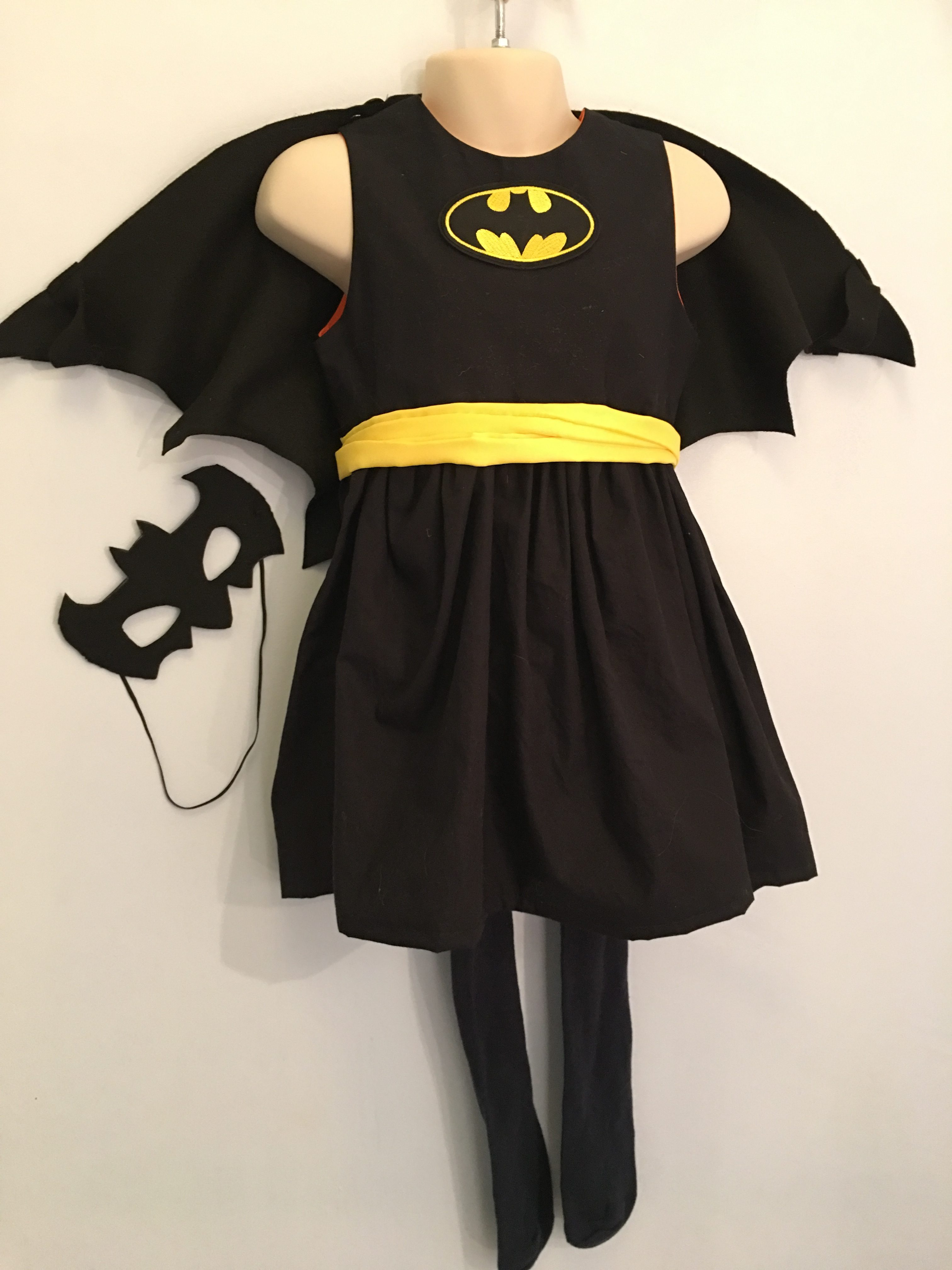 Batgirl Halloween Outfits Made Around A simple Black Dress - outfits for children dressing up that use a black dress as their base #halloweencostumes #halloweenoutfits #halloweenpartyideas #halloweencostumesforkids #halloweendiy #halloweencrafts #halloweencostumeideas #halloweenwitch #dressingup #dressupideas #batgirl