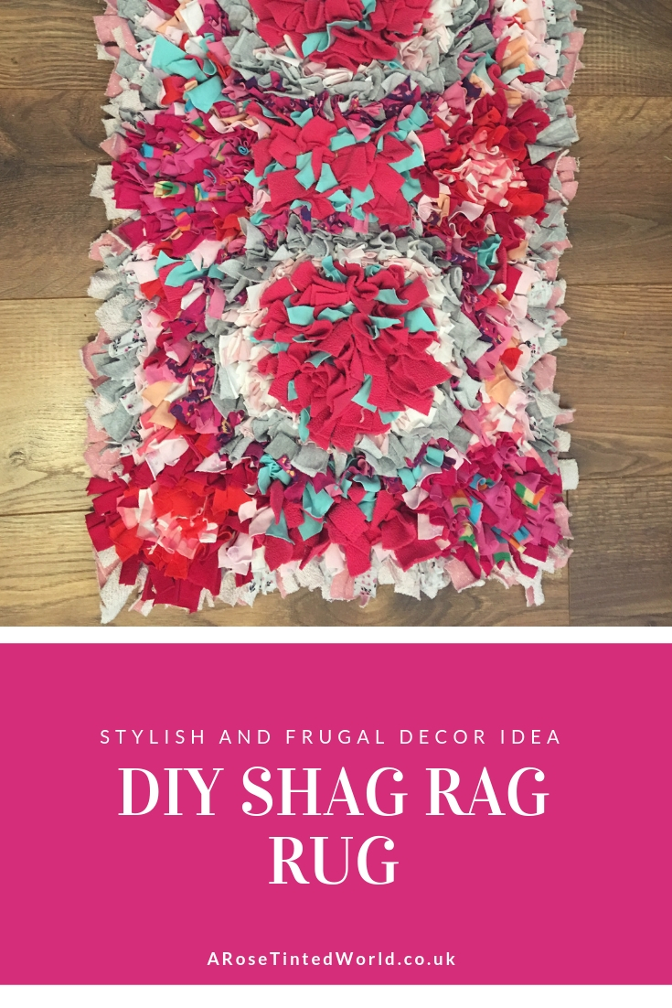 Making A Rag Rug - a frugal zero waste way of using old clothes to make a lovely decorative floor cover. Also known as a clip rug or proddy rug. Upcycle jersey fabric cloth scraps or worn out knit garments to create this brilliant floor covering. DIY your own rug using this tutorial. Full instructions on how to make this lovely shaggy rug. #sustainable #sustainableliving #zerowaste #zerowasteliving #zerowastelifestyle #ragrug #proddyrug #ragrugsproject #upcycling #upcycleoldclothes