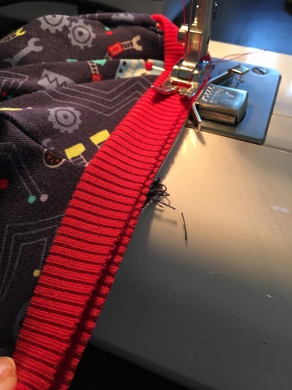 How To Sew A Neck Band Into A Stretch Garment - sewing the neck band in place