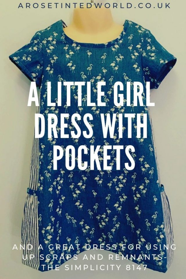 A Little Girl Dress With Pockets - The Simplicity 8147 is the perfect scrap busting, zero waste pattern for using up all your remnants and fat quarters. A cute little dress, it is designed to be made in knit stretch fabrics, but I hacked the pattern to make it in woven fabrics too. See my finished result. And it has pockets! #Beginnerssewingpattern #novicesewingpattern #sewingforchildren #littlegirldress #sewingpatterns #simplicity8147 #ithaspockets #scrapbustingsewingpatterns #scrapbustingsewing #fatquarter #fatquartersewing #zerowastesewingpattern #zerowastesewing #sustainablesewing #upcyclingpattern #sewingpattern #sewingtips