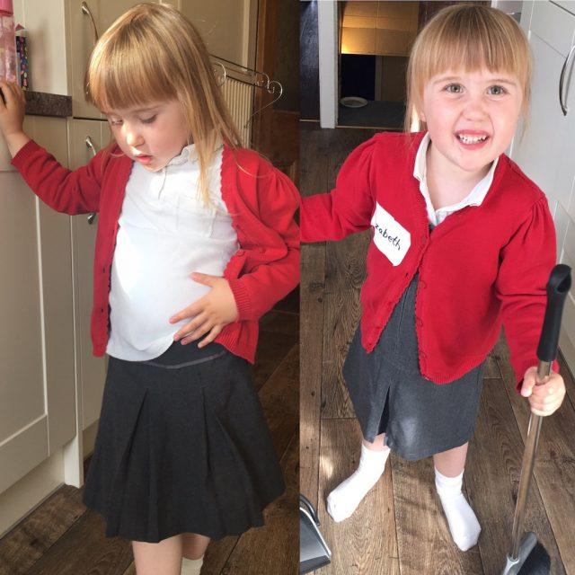 She loves her new school uniform!