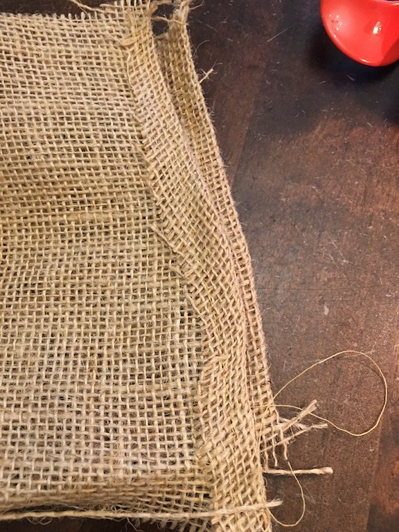 Hem the ends of the hessian strips
