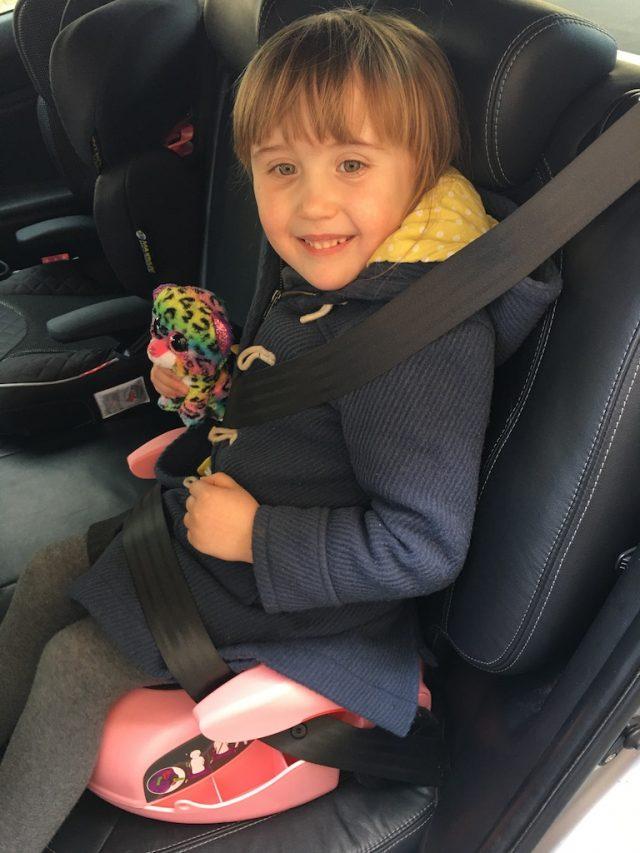 E sat on the CarGoSeat in the car