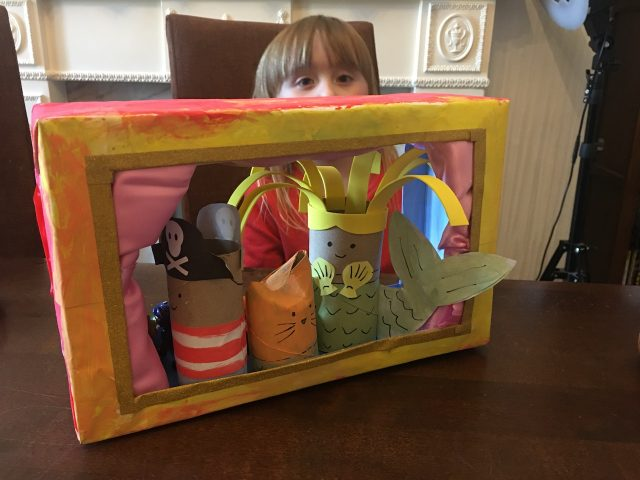 Playing with the puppet theatre