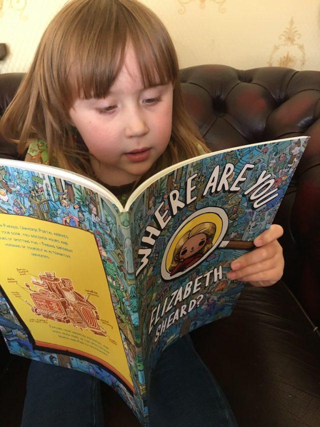 Elizabeth reading her Wonderbly book