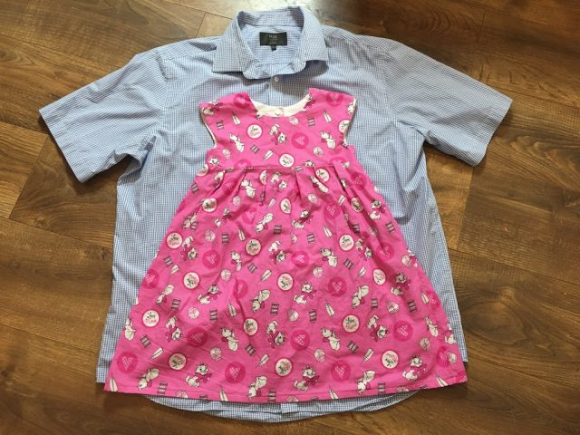 Lay the shirt flat with a dress to act as a dress template