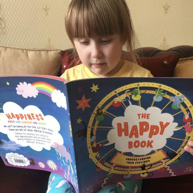 Elizabeth reading the happy book