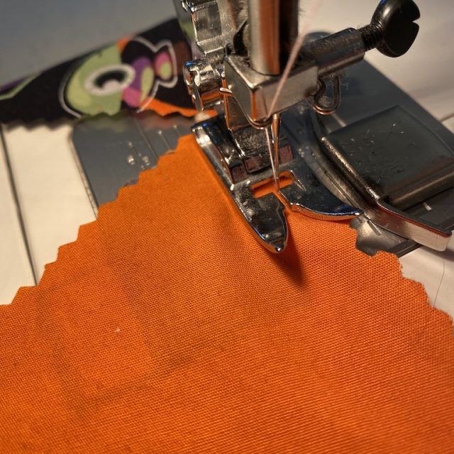 Sew triangles to twill tape