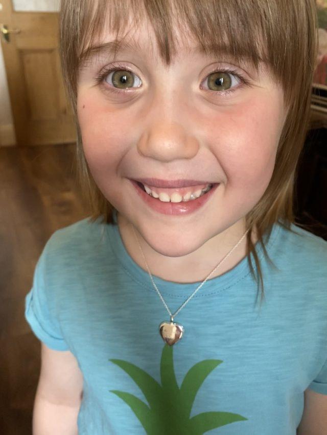 Elizabeth wearing her locket