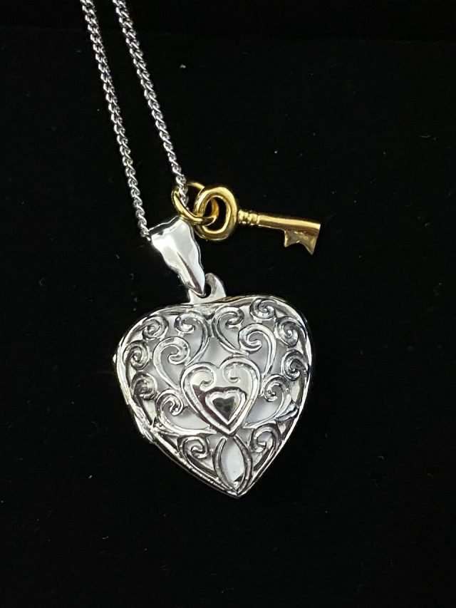 Lily Blanche Key Locket Review - we were sent a white gold filigree heart locket with yellow gold charm for our opinion. Is it a good gift idea? See our thoughts.